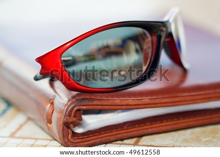 Notebook and sunglasses . close up. selective focus. shallow DOF. - stock photo