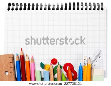 Notebook and supplies - stock photo