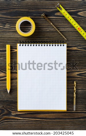 Notebook and technical tools on the table - stock photo