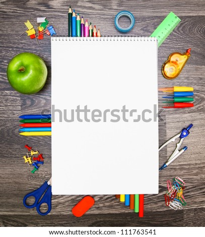 Notebook and the school tools. - stock photo