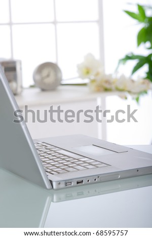 notebook at home office - stock photo