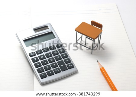 Notebook, calculator, pencil and miniature desk  / Study or student insurance image - stock photo
