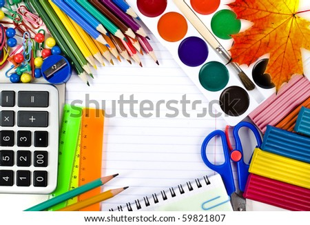 Notebook , colored pencils, back to school concept surface  with copy space over white background  - stock photo