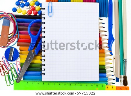 Notebook , colored pencils, back to school, copy space for text over white background  - stock photo