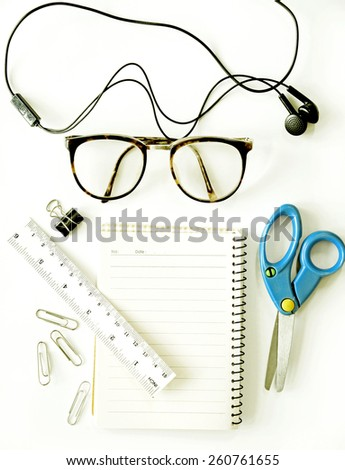 notebook, eyeglasses, scissors (office tools)