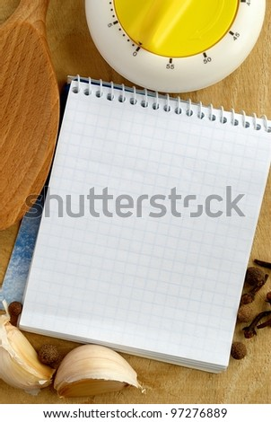 notebook for recipes and vegetables on the table