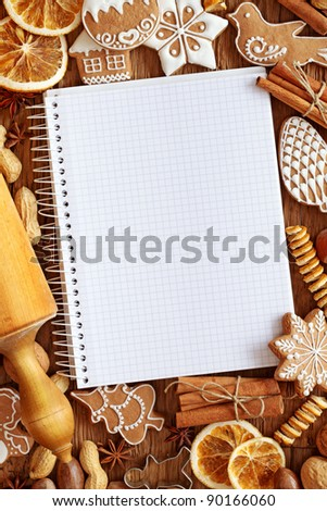 Notebook for recipes of christmas cakes - stock photo