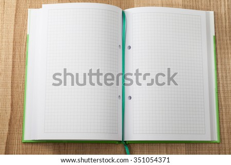 Notebook for records checkered closeup - stock photo