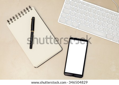 Notebook, Fountain Pen and Smartphone on Desk (Phone Screen Includes Clipping Path)