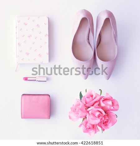 Notebook, heel shoes, roses, lipstick and wallet flat lay - stock photo