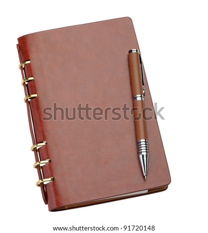 Notebook in a brown leather cover and stylish pen. It is isolated on a white background - stock photo