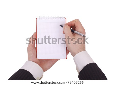 Notebook in hand - stock photo