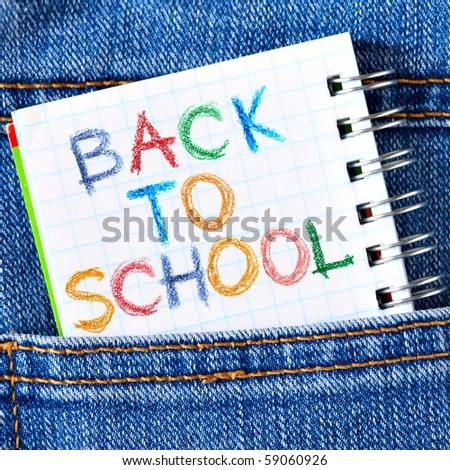 Notebook in jeans poket with phrase Back To School - stock photo
