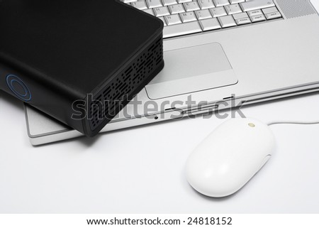 notebook, mouse and an external hard drive
