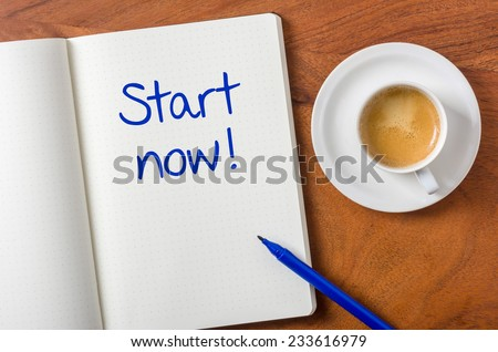 Notebook on a desk - Start now - stock photo
