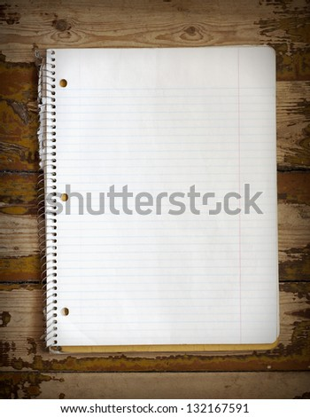 Notebook on a grunge wooden floor background - stock photo