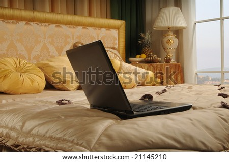 notebook on a luxurious bed in a hotel