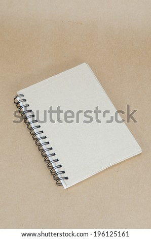 notebook on brown background - stock photo