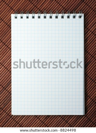 notebook on brown bamboo mat - stock photo