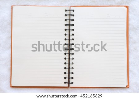 notebook on fabric background, Top view