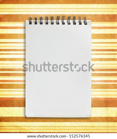 Notebook on grunge background.