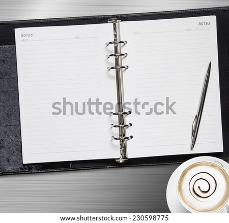 Notebook on metal background