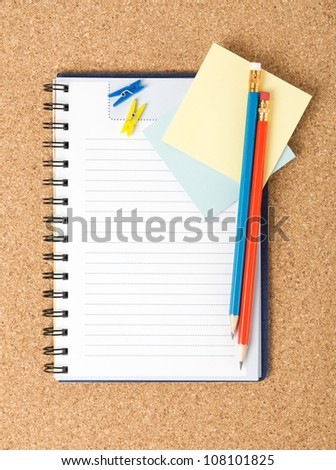 Notebook on the cork background - stock photo