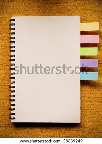 Notebook on the fabric texture. - stock photo