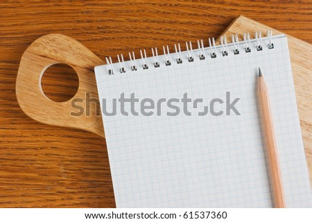 notebook on the kitchen board isolated on white background
