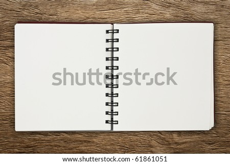 notebook on wood - stock photo
