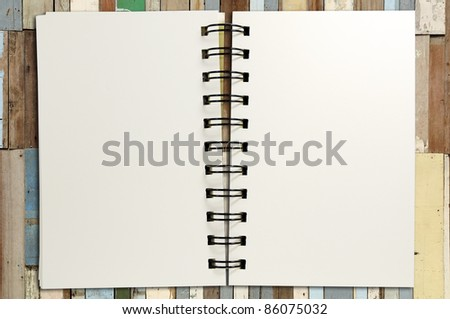 Notebook on wood ancient background - stock photo