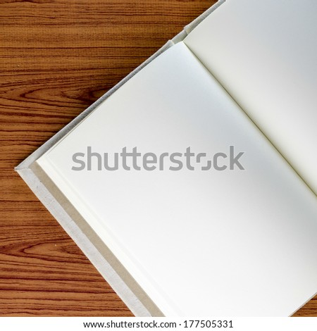 notebook on wood background - stock photo