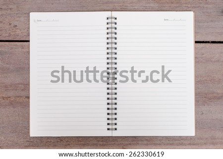 notebook on wooden table. - stock photo