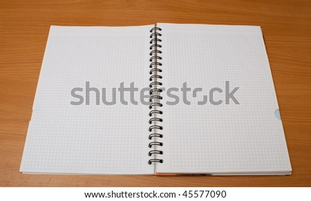 notebook on wooden table - stock photo