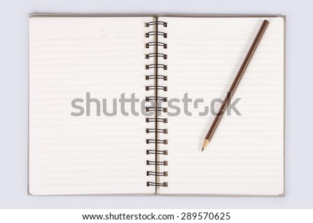 notebook open blank page with line and date text in the corner on white background, that has black spiral ring binder, and a pencil put on the right page