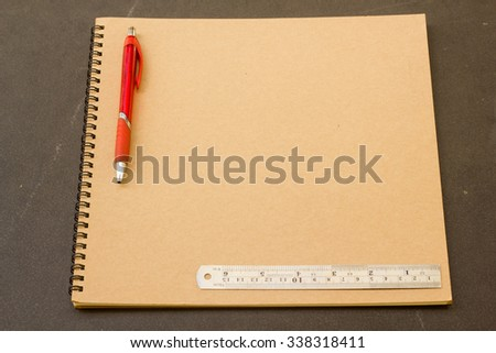 Notebook or booklet with 2B pencil or pencil or pen and steel ruler  for education and work.