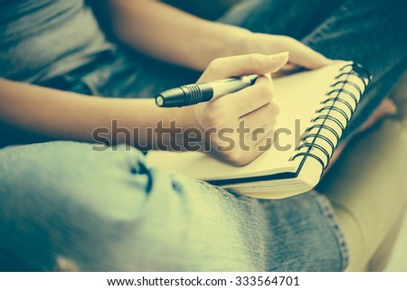 Notebook or sketchbook in hands. Creativity, art and education concept.  Toned image - stock photo