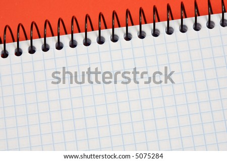 notebook over a red background    - write your text - - stock photo