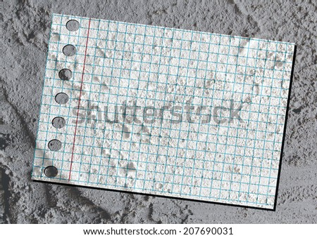 notebook paper on Cement wall texture background design - stock photo