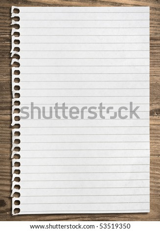 Notebook paper sheet on a wooden table, clipping path. - stock photo