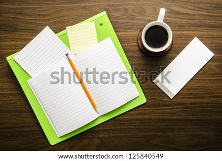 Notebook, papers and coffee - stock photo