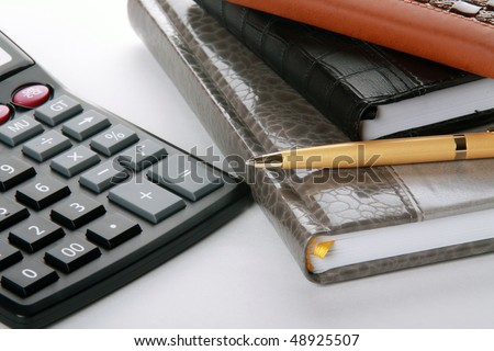 Notebook , pen and calculator, close-up