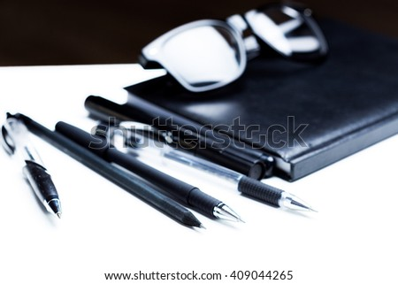 Notebook, pencil and glasses - stock photo