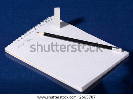 Notebook, pencil and rubber on blue background - stock photo