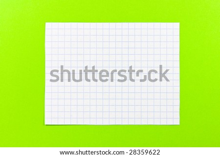 notebook piece on green background - stock photo