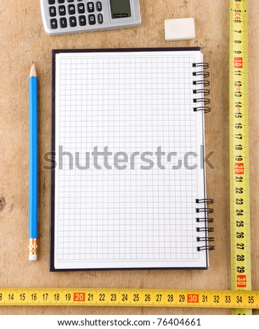notebook, school and office accessories on wooden texture