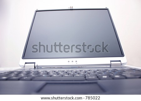 notebook screen with blurred out keyboard