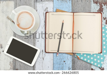 notebook smart phone and coffee cup on wood table - stock photo