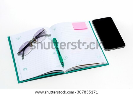 notebook, smartphone, eye glasses, and pen, On a white background