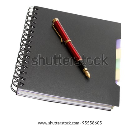 notebook with binding and fountain pen isolated on the white background